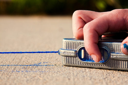 image of snapping chalk lines