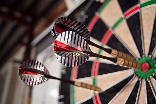 image of dartboard and darts
